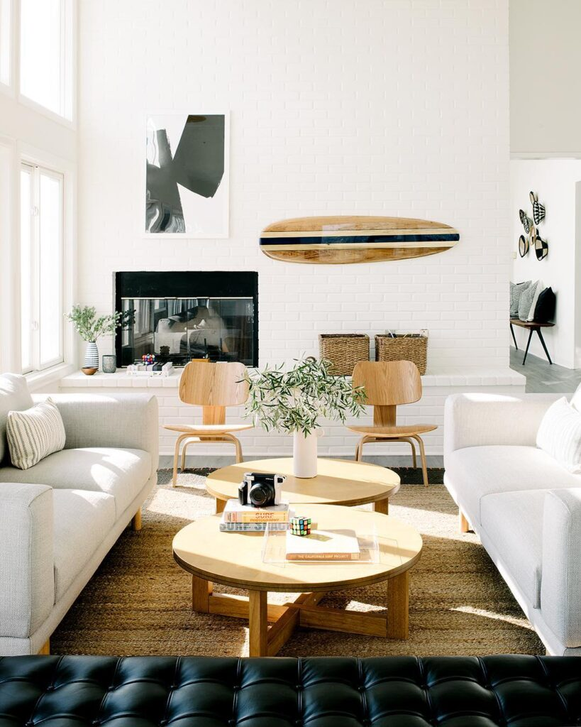 bright living room with surfboard